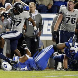 Devin Centers (37) of the Utah State Aggies runs the ball against BYU during NCAA football in Provo, Friday, Oct. 3, 2014.