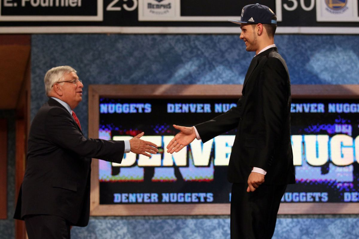 Evan Fournier from France greets NBA Commissioner David Stern after he was selected number twenty overall by the Denver Nuggets.