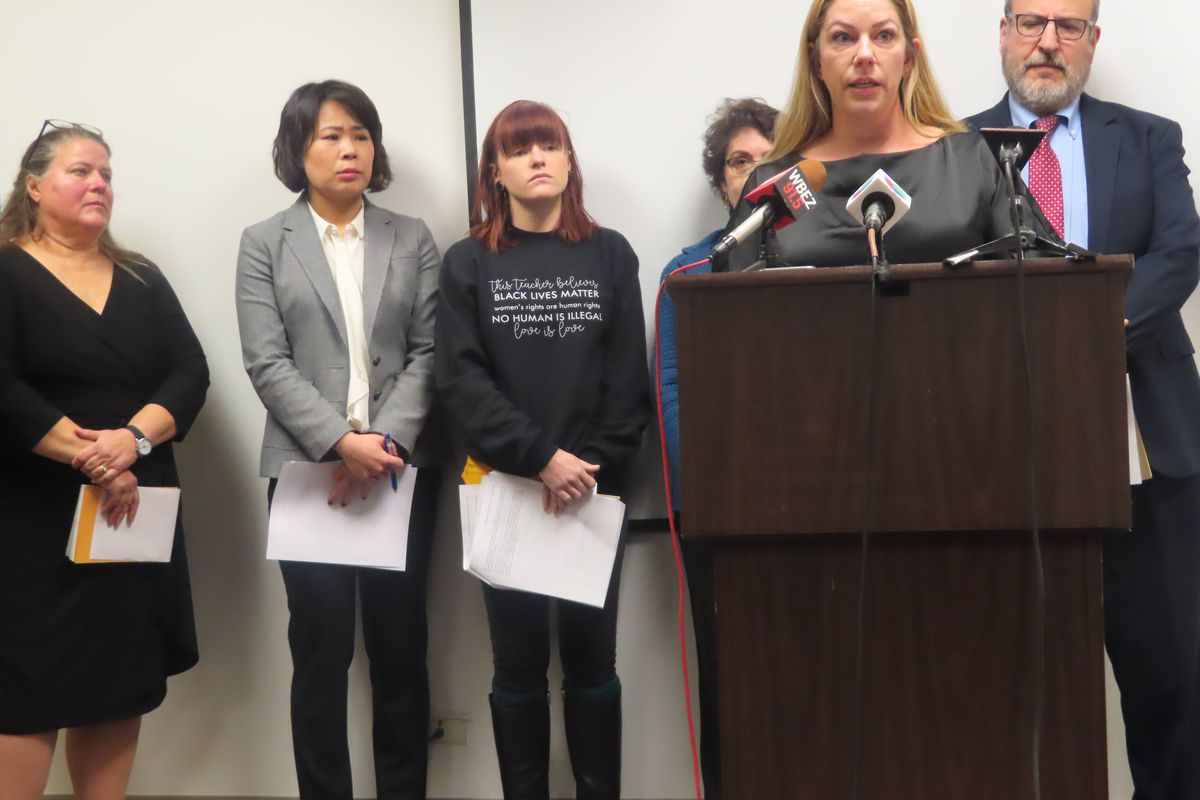 Laurel Henson, at the podium, spoke at a press conference in Chicago on Nov. 12, 2018, about her 2-year struggle to get a school nurse on staff to help her son, who suffers from seizures.