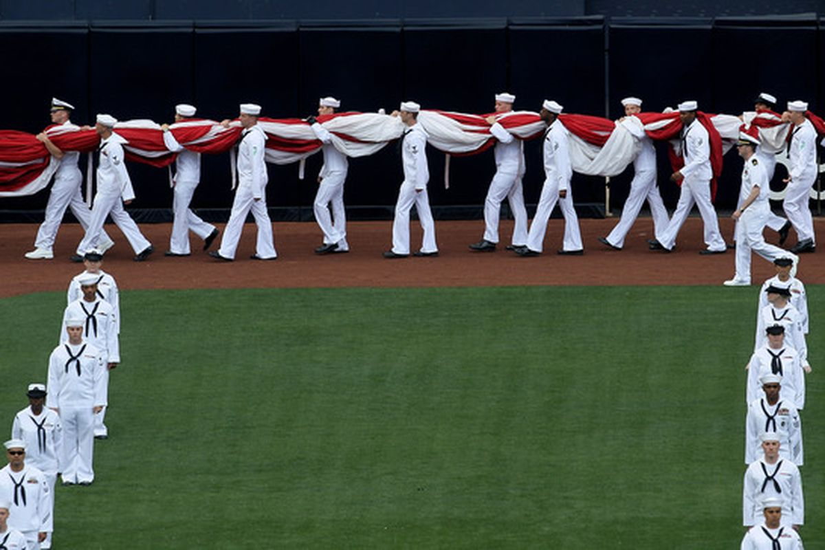 Members of the US Navy carrying the flag on Opening Day 2010 between the Padres and Braves at Petco Park. USA! USA! USA! USA!