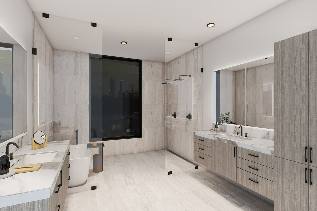 A big white bathroom with dual vanities.