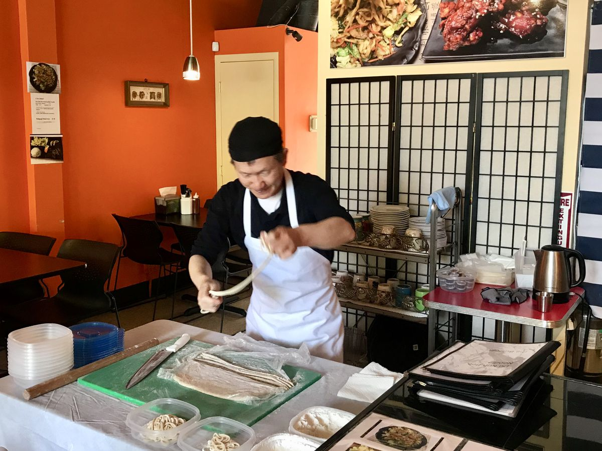 man making hand-pulled noodles