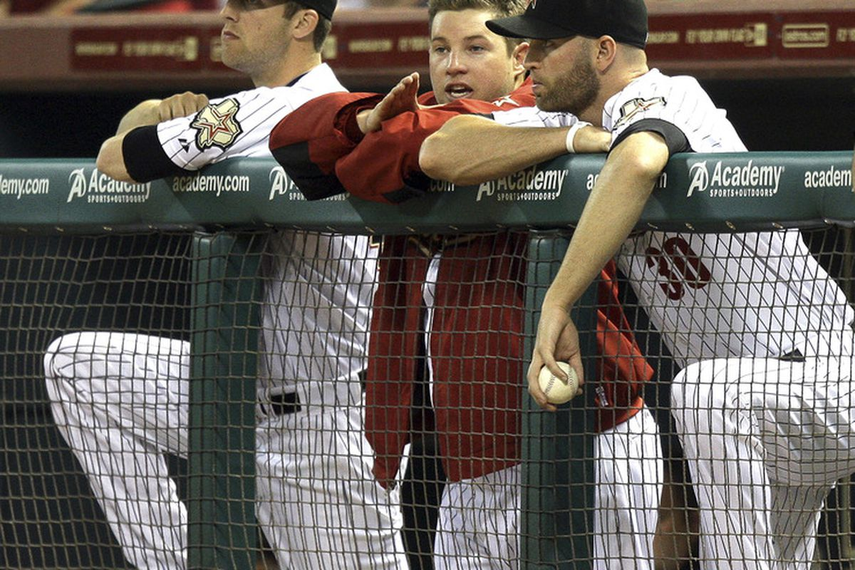 HOUSTON - JUNE 08:  Pitcher Bud Norris, center, of the Houston Astros talks with J.A. Happ #30 and Jordan Lyles after being removed from the game at Minute Maid Park on June 8, 2011 in Houston, Texas.  (Photo by Bob Levey/Getty Images)
