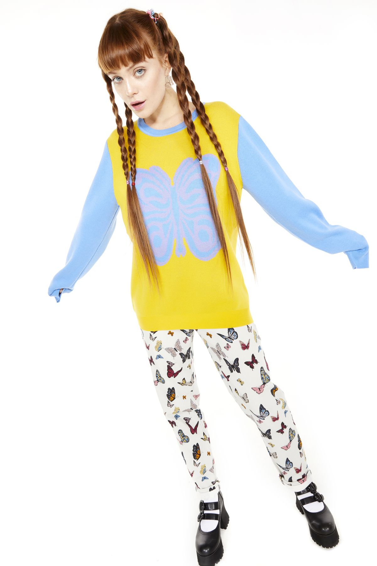 A model wears a similar yellow and blue butterfly sweater.