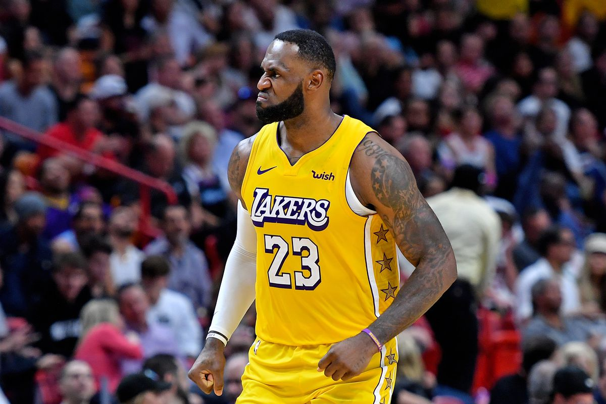 Los Angeles Lakers forward LeBron James reacts during the second half against the Miami Heat at American Airlines Arena.