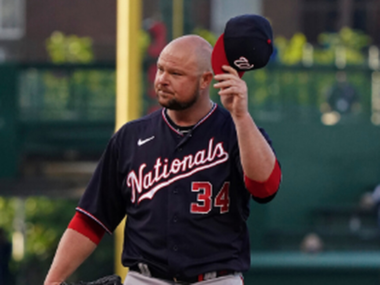 Former Cubs left-hander Jon Lester tips his cap to the crowd after taking the mound in the first inning Monday for the Nationals at Wrigley Field.