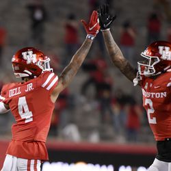 Houston wide receiver Nathaniel Dell (4) celebrates his touchdown with Deontay Anderson during the first half of an NCAA college football game against BYU, Friday, Oct. 16, 2020, in Houston.