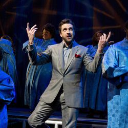 """In this theater image released by Boneau/Bryan-Brown, Raul Esparza is shown during a performance of """"Leap of Faith,"""" at the St. James Theatre in New York."""