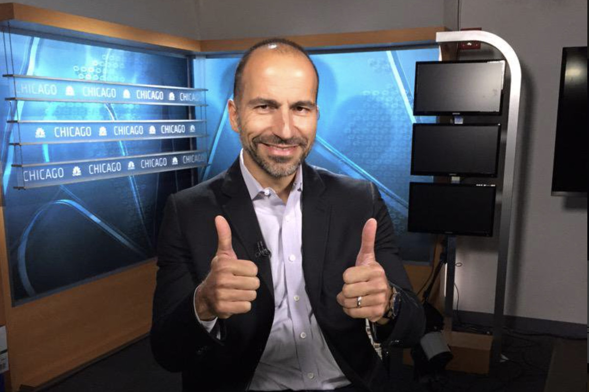 Dara Khosrowshahi smiles and gives two thumbs up on the set of a TV new program.