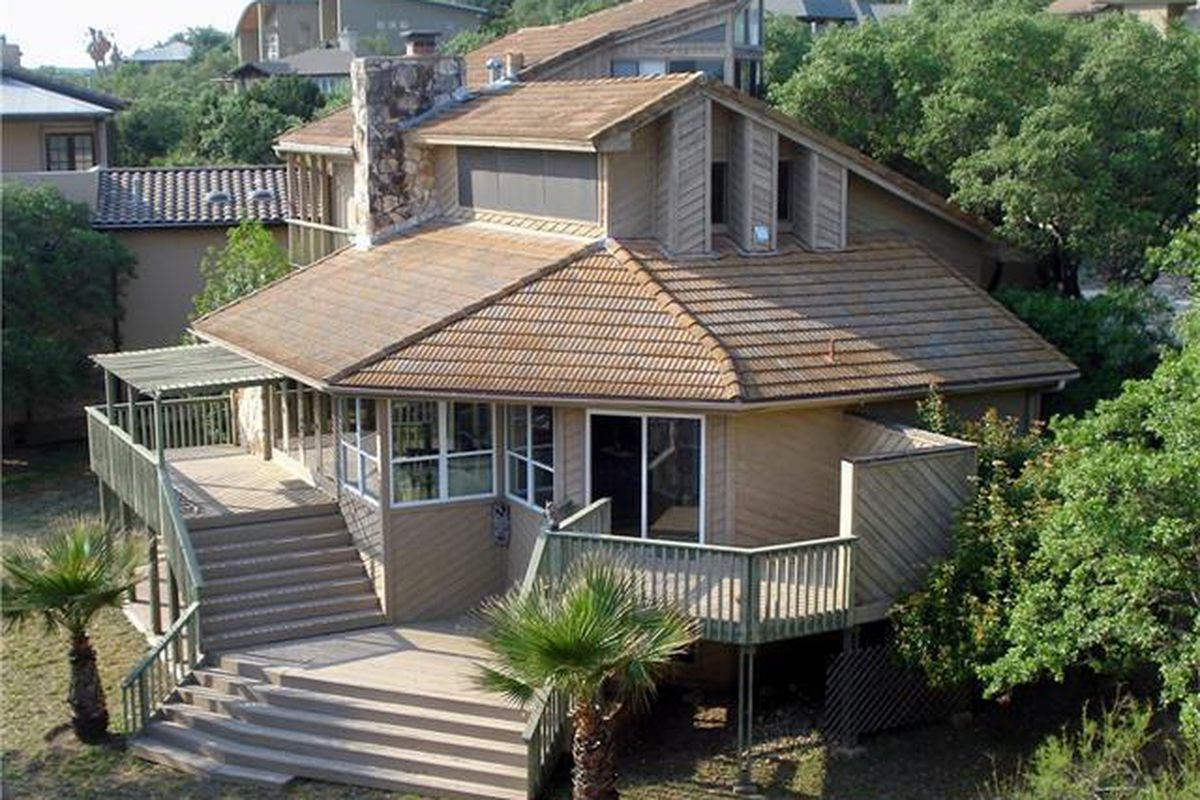 Wooden house with multiple decks and levels, almost beach house looking