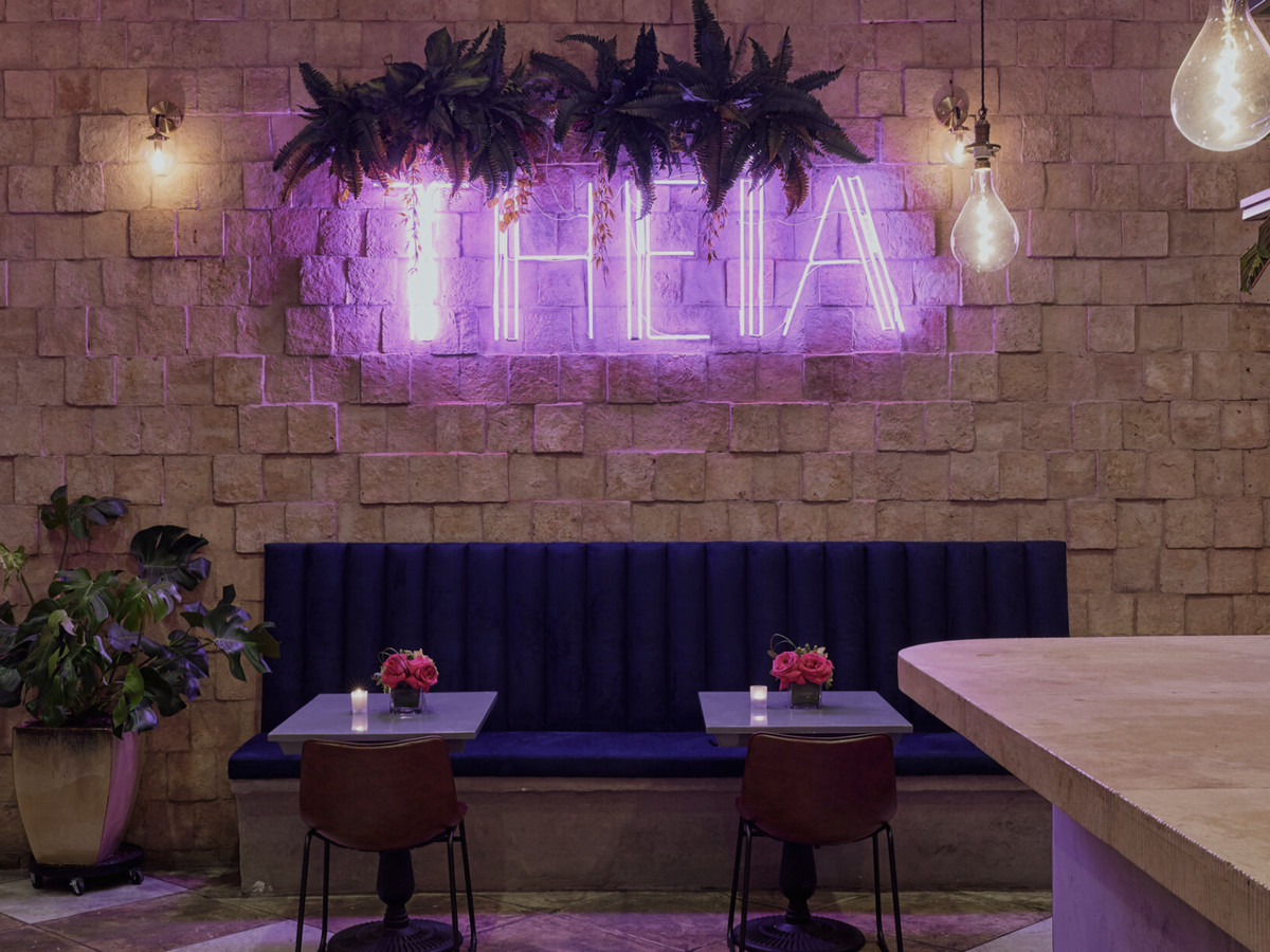 Theia West Third interior with glowing neon sign