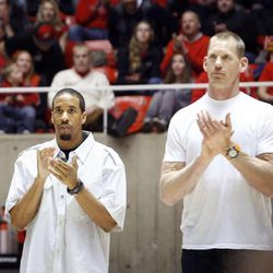 Former Utah basketball players including Mike Doleac, far right, and Andre Miller, attend a halftime tribute honoring the late Rick Majerus at the University of Utah's Huntsman Center in Salt Lake City on Saturday, Feb.2, 2013. Coach Majerus, who passed away Dec. 1, coached the Utes from 1989-2004 — posting a 323-95 record and an appearance in the 1998 NCAA championship game.