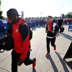 Utah players smile as they walk past BYU fans who are booing them as they arrive for an NCAA football game at LaVell Edwards Stadium in Provo on Saturday, Sept. 11, 2021.