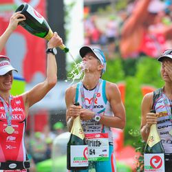 Mirinda Carfrae (C) of Australia celebrates with second placed Rachel Joyce of Great Britain (R) and third placed Caroline Steffen of Switzerland after winning the Challenge Roth on July 20, 2014 in Roth, Germany. (Photo by Lennart Preiss/Getty Images)
