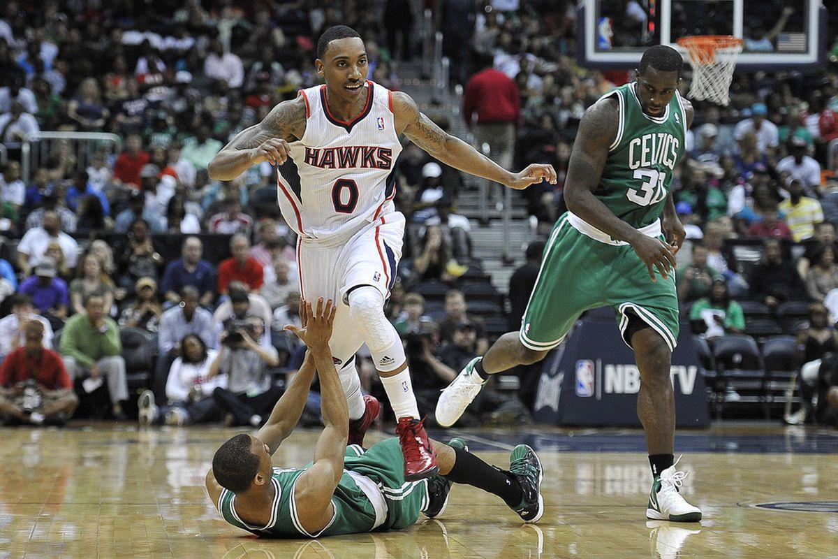 Apr 20, 2012; Atlanta, GA, USA; Boston Celtics shooting guard Avery Bradley (0) is fouled by Atlanta Hawks point guard Jeff Teague (0) during the second half at Philips Arena. The Hawks won 97-92. Mandatory Credit: Paul Abell-US PRESSWIRE