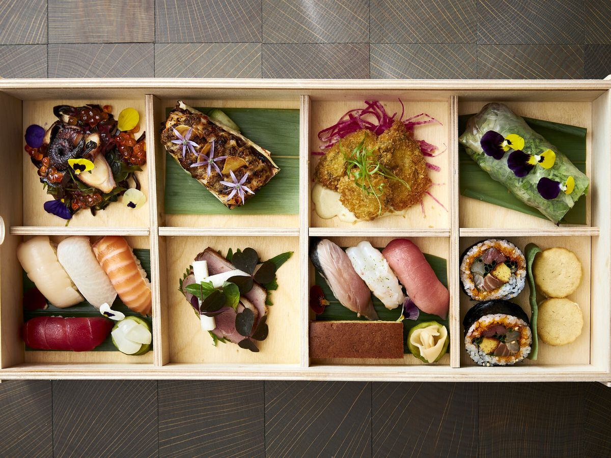 A small wooden box holds eight courses of omakase.