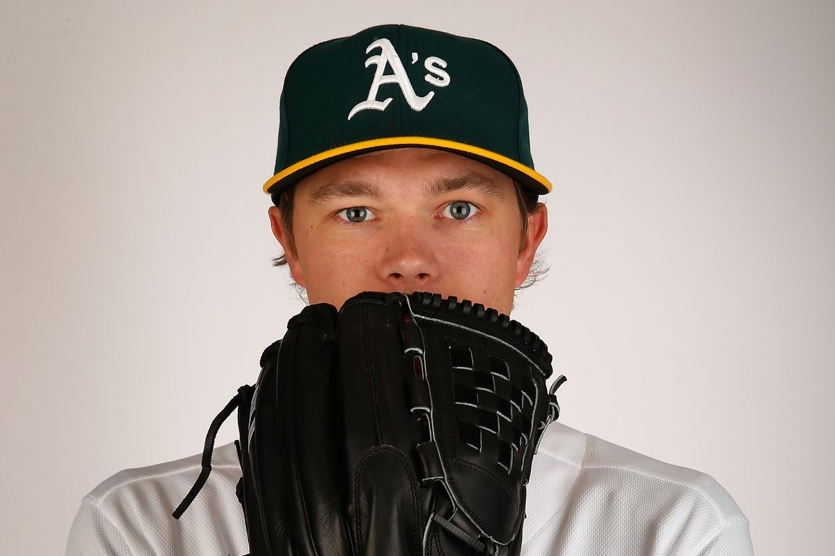 Sonny Gray, apparently using his glove as a vomit receptacle.