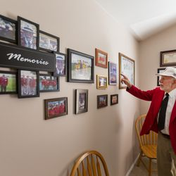 """Longtime track starter Gerard """"Jerry"""" Collet points out special memories and people as he reminisces at his South Jordan home on Tuesday, April 28, 2020, about all the different places around the country that he has been an official."""