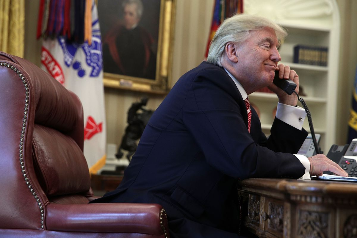 President Donald Trump on the phone in the Oval Office.
