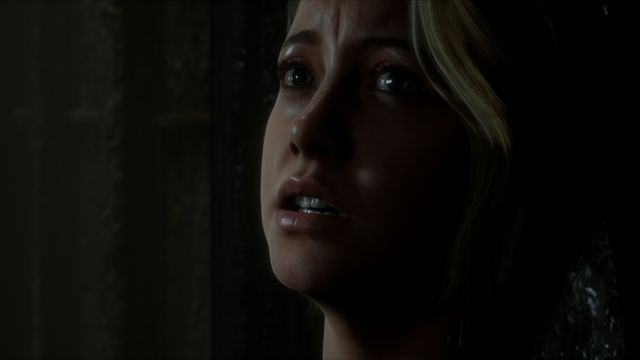 a close-up of Julia, a white blond-haired woman, looking terrified and alarmed in Man of Medan