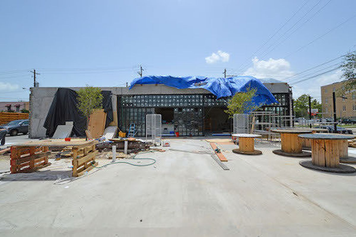 View from parking lot looking toward patio and front door.