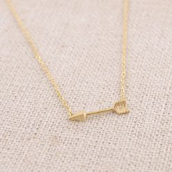 """Love gets playful with this stylish <b>Arrow Necklace</b>. We like this handmade version that features a delicate dart on a dainty chain. Choose from gold or silver finish. From GypsyTraderBoutique on <a href=""""https://www.etsy.com/listing/217959803/arrow-"""