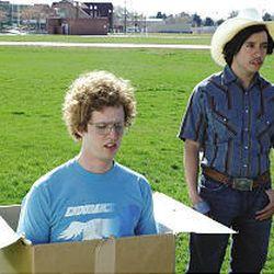 Napoleon (Jon Heder) waits for Pedro (Efren Ramirez) to push him in the box of wonders.