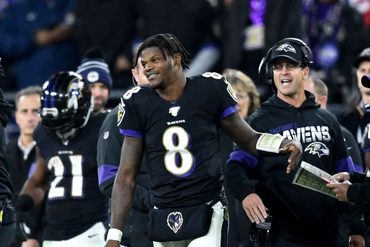 Baltimore Ravens quarterback Lamar Jackson and head coach John Harbaugh react during the fourth quarter against the New England Patriots at M&T Bank Stadium.