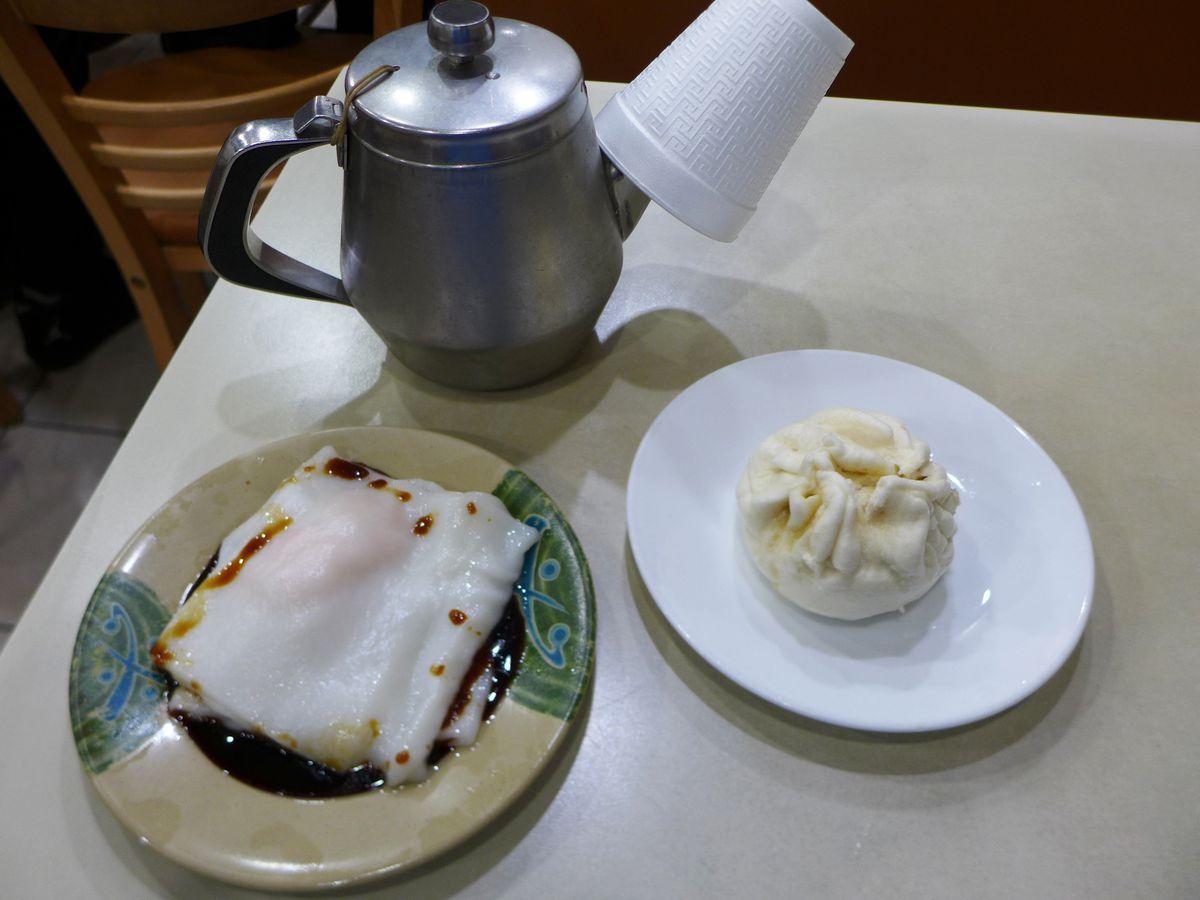 Rice noodle roll and char siu bao, with a shiny teapot.
