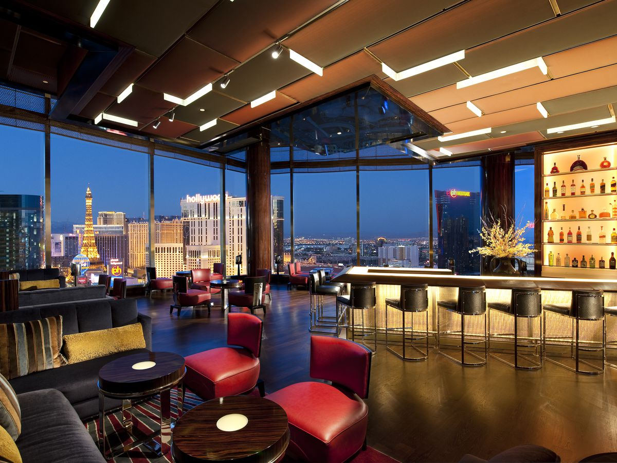 A pretty lit bar with windows overlooking the Las Vegas Strip.