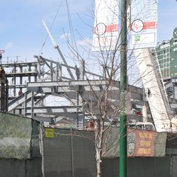 Left field video board structure visible in the background, behind the right field bleachers -
