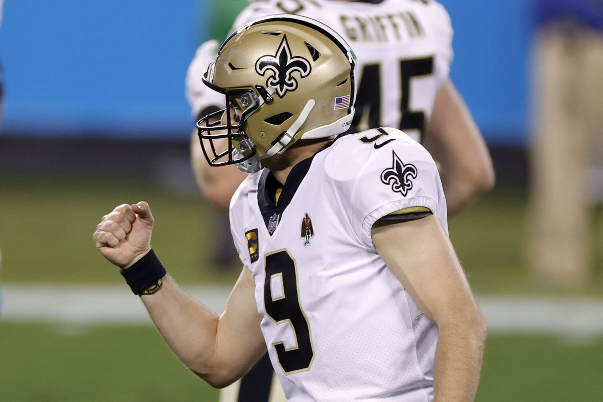Quarterback Drew Brees #9 of the New Orleans Saints reacts after throwing a touchdown pass during the second half of their game against the Carolina Panthers at Bank of America Stadium on January 03, 2021 in Charlotte, North Carolina.