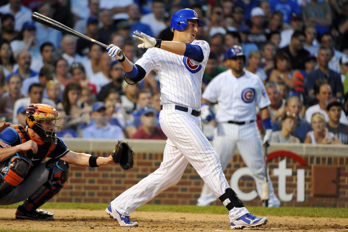 Chicago, IL, USA; Chicago Cubs right fielder Bryan LaHair hits a single against the Miami Marlins at Wrigley Field. Credit: Rob Grabowski-US PRESSWIRE