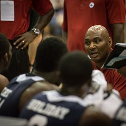 Michael Curry speaks to his bench