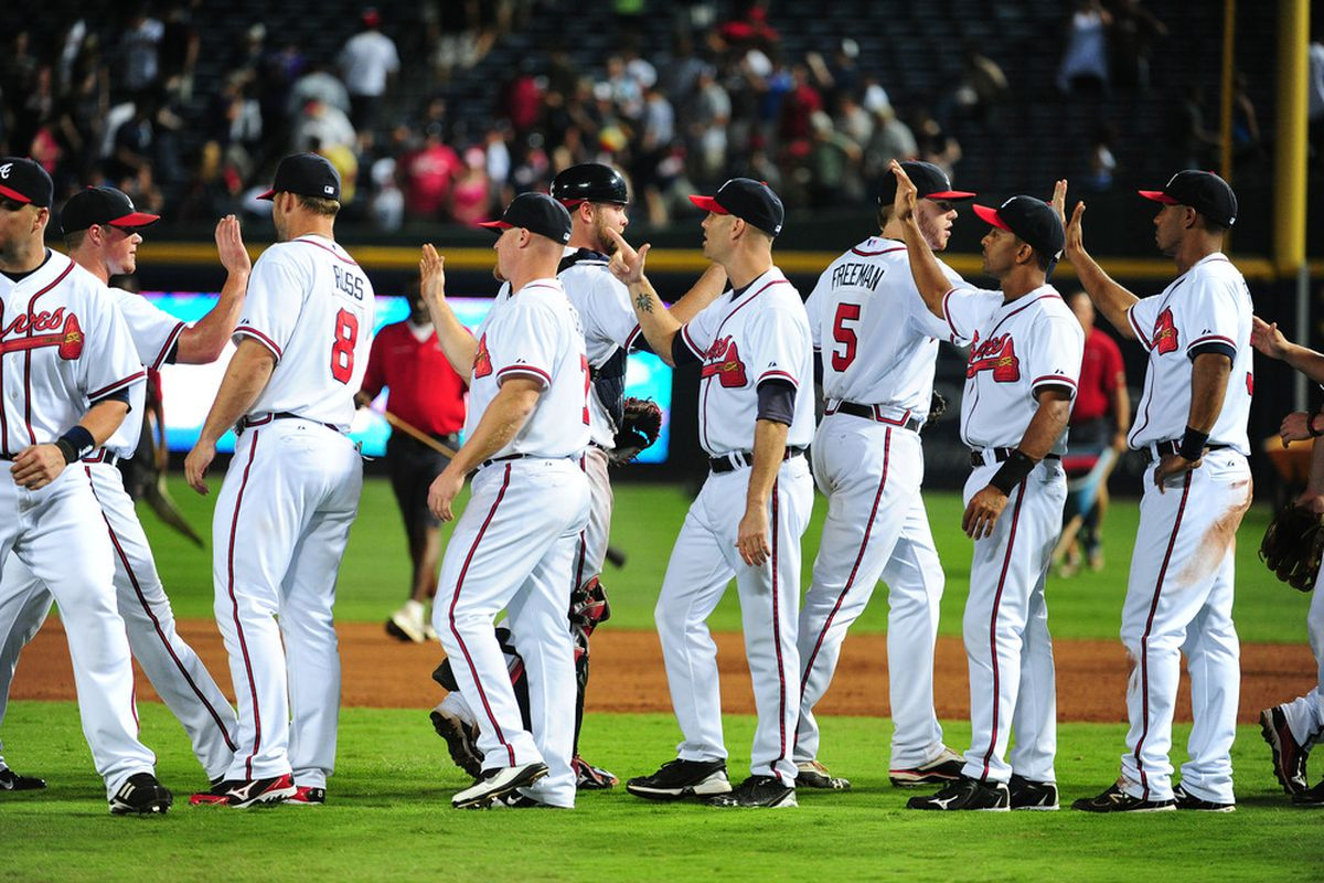ATLANTA - JULY 5: Members of the Atlanta Braves celebrate after the game against the Colorado Rockies at Turner Field on July 5, 2011 in Atlanta, Georgia. (Photo by Scott Cunningham/Getty Images)