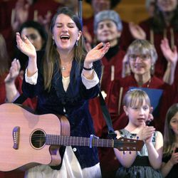 Karen Nielsen-Anson sings along with the Congregation Kol Ami Jewish Children's Choir during the Interfaith Musical Tribute to the Human Spirit at the Tabernacle in Salt Lake City, Utah, Sunday, Feb. 8, 2009.