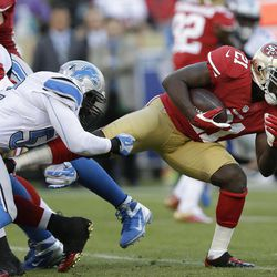 San Francisco 49ers running back Frank Gore, right, runs with the ball but is stopped by Detroit Lions outside linebacker Justin Durant, left, during the first quarter of an NFL football game in San Francisco, Sunday, Sept. 16, 2012.