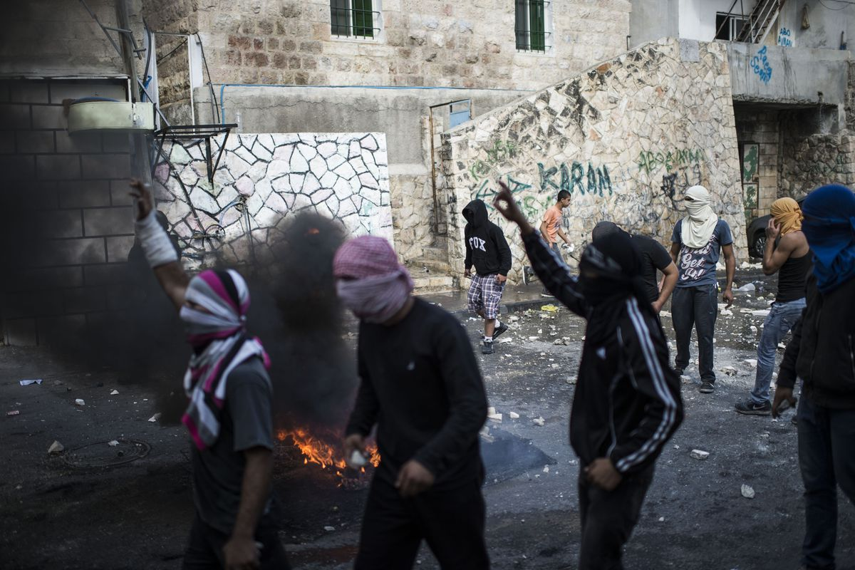 Palestinians clashing with Israeli security forces in Jerusalem on October 30.