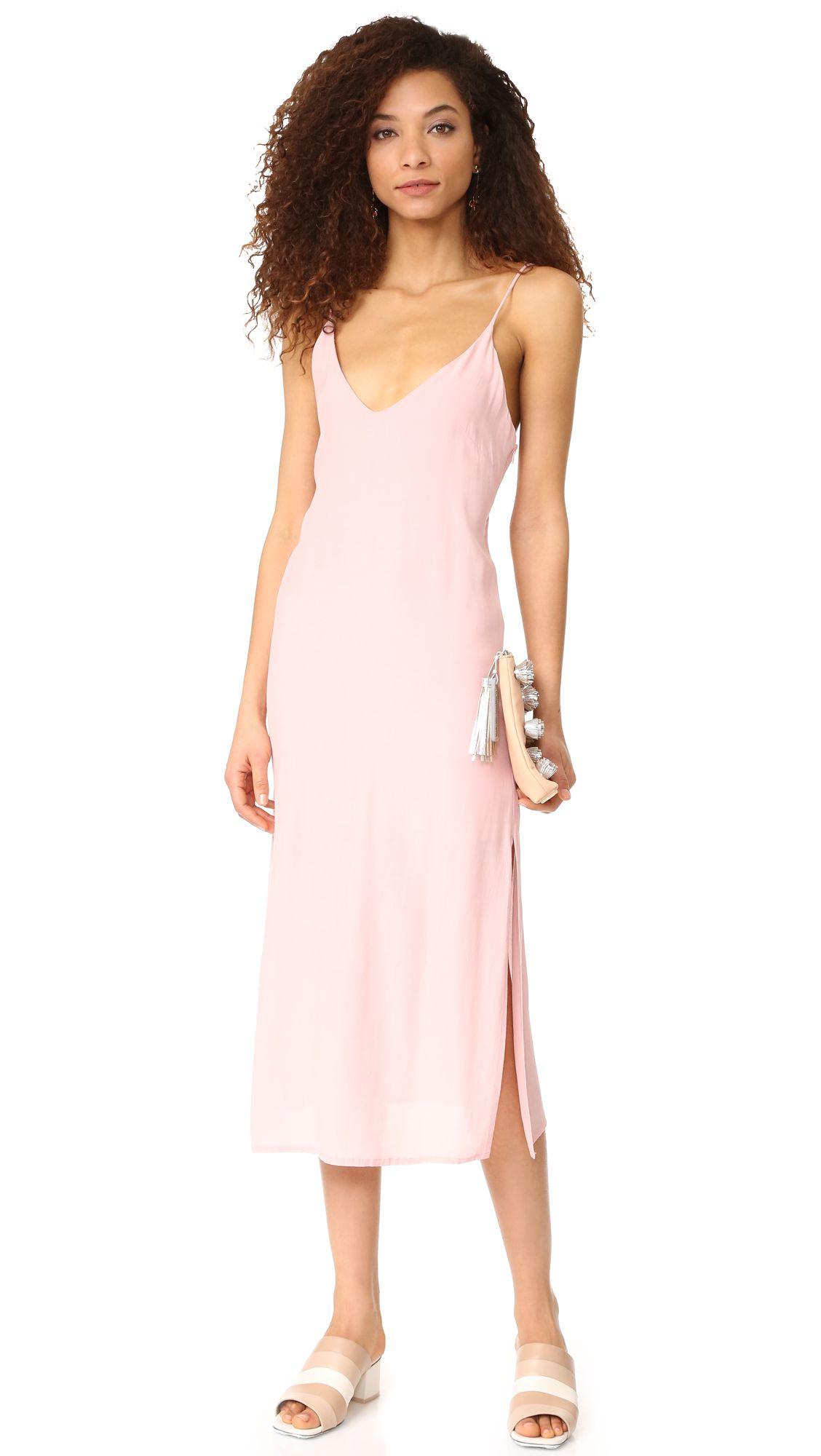 A model in a pink slip dress
