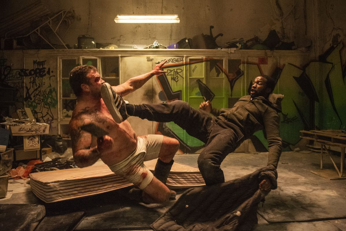 Two guys fighting in a dingy locker room in Gangs of London
