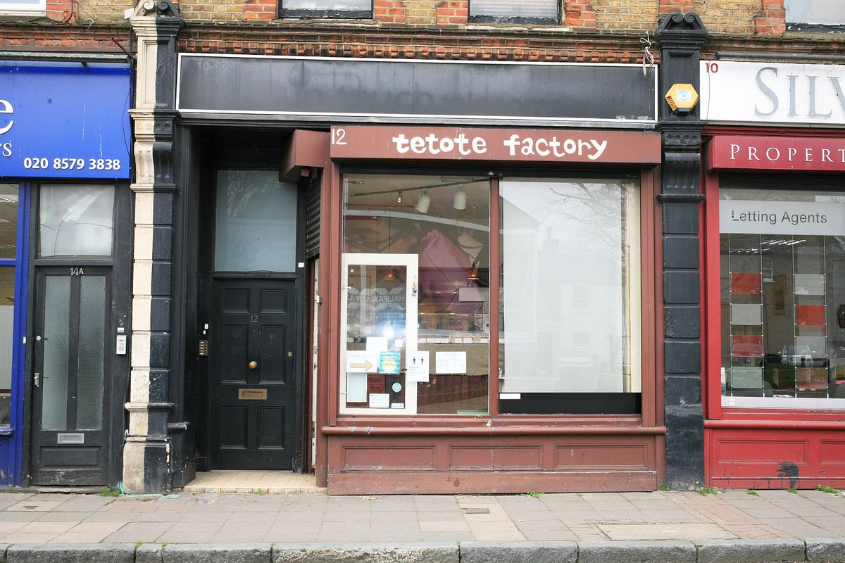 The brown exterior of Tetote Factory in Ealng, with the name written in white, lowercase cartoon lettering above the front window