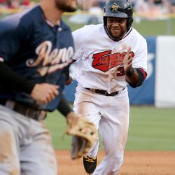 The Salt Lake Bees' Cesar Puello runs for third base during a baseball game against the Reno Aces in a baseball game at Smith's Ballpark in Salt Lake City on Monday, June 26, 2017. The Bees wore Trappers jerseys for '80s throwback night.