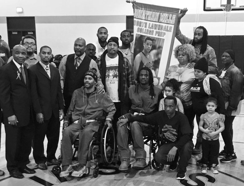 (L-R) In wheelchairs, gun violence victims Coach Shawn Harrington and former North Lawndale player Jermaine Winfield at an event honoring Jonathan Mills, a former North Lawndale star who was gunned down on the sidewalk on the way to the gym. Mills' mother