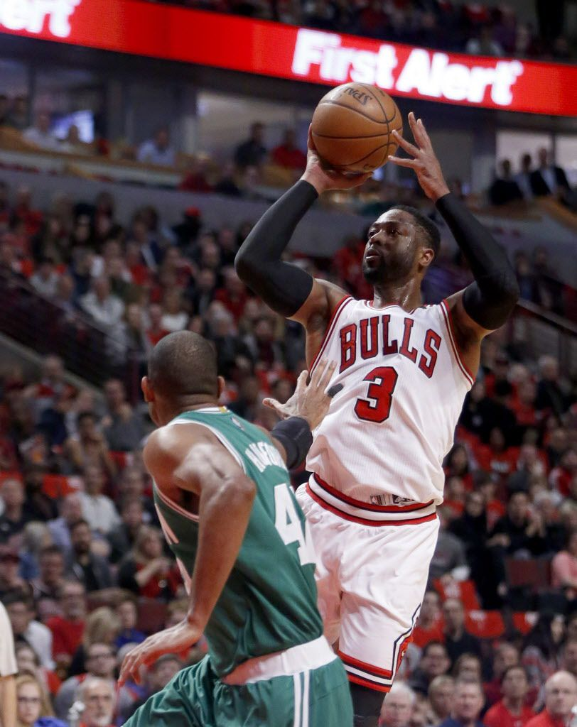 Bulls' Dwyane Wade (3) shoots over Boston Celtics' Al Horford during the first quarter of Game 3 of a first-round NBA basketball playoff series in Chicago, Friday, April 21, 2017. (AP Photo/Charles Rex Arbogast)