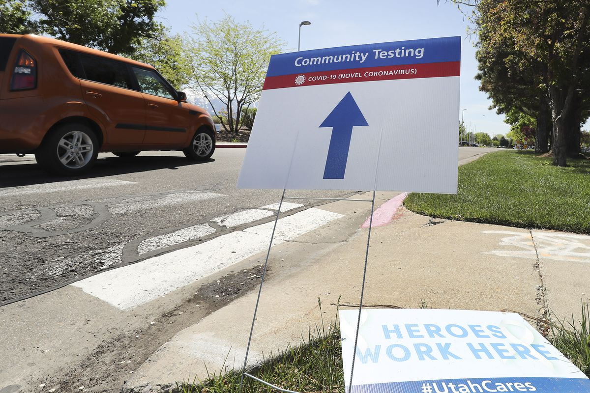 A sign points people to where COVID-19 testing is being performed at Intermountain Healthcare's Cottonwood InstaCare in Murray on Tuesday, May 5, 2020.