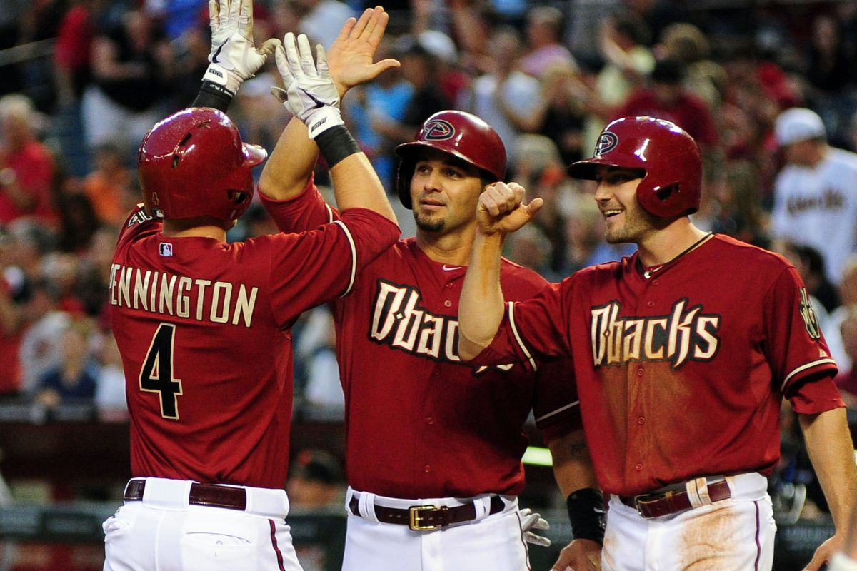 A.J. Pollock goes for the fist-pound instead of the high-five, rookie mistake.
