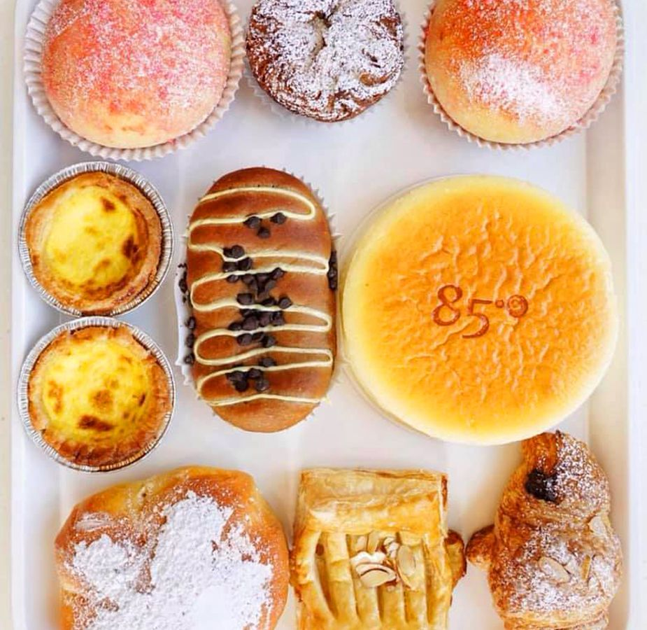 A selection of European and Asian-inspired pastries and cakes at 85C Bakery Cafe.