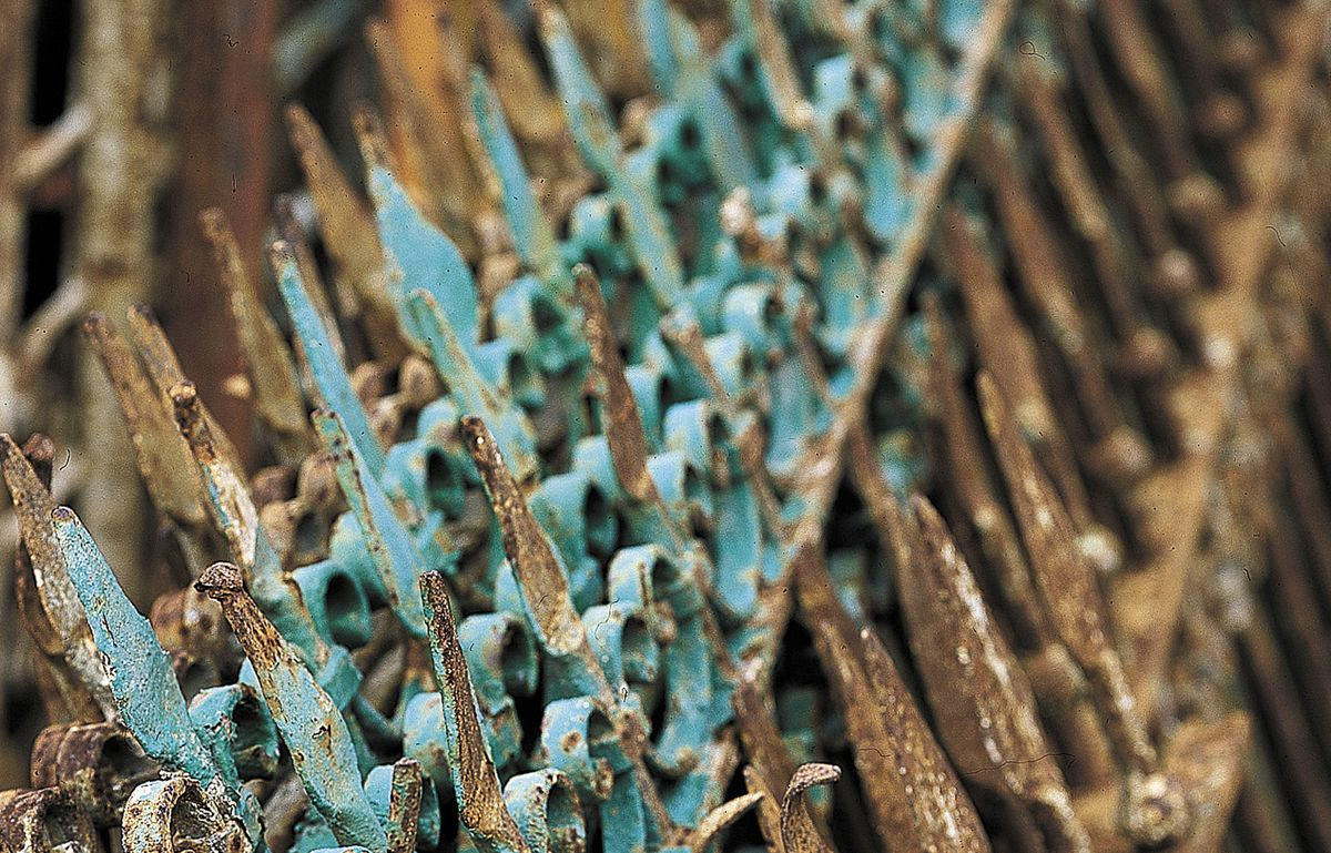 <p>Old wrought-iron fence sections like these are often covered with peeling paint and more than a hundred years' worth of rust</p>