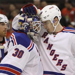 New York Rangers' Chris Kreider (20) celebrates with goaltender Henrik Lundquist (30) after the Rangers defeated the Ottawa Senators 3-2 during Game 6 of a first-round NHL Stanley Cup playoff hockey series, in Ottawa, Ontario, on Monday, April 23, 2012.