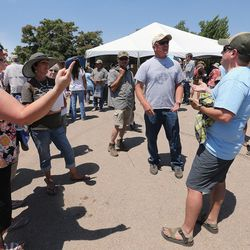 Kim Henderson of Monticello, Arleen Hurst of Blanding, and George Rice of Monticello argue with a man who declined to give his name about the proposed Bears Ears National Monument prior to a meeting with Interior Secretary Sally Jewell, in Bluff in southern Utah on Saturday, July 16, 2016.